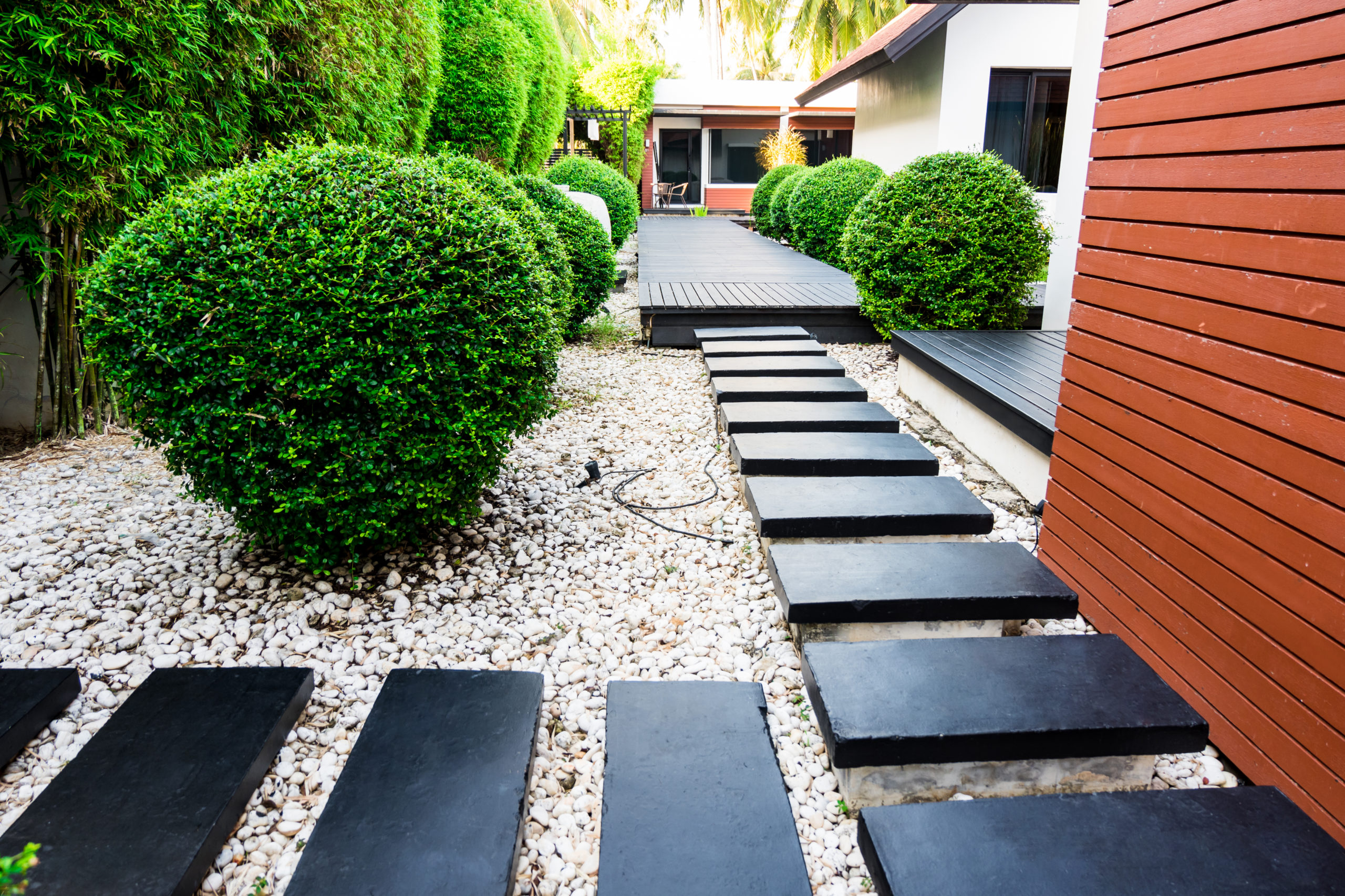 Decorative Rocks for Landscaping: 3 Backyard Design Ideas ... on Black And White Patio Ideas id=22305