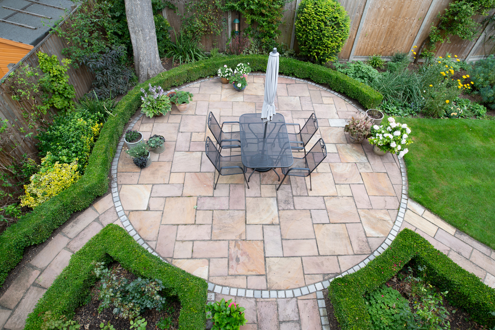 circular garden patio with freshly jet washed paving stones to fit your home