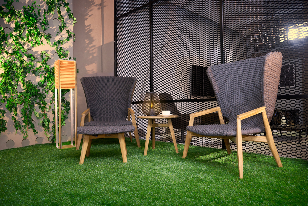 artificial grass in yard with patio furniture on top
